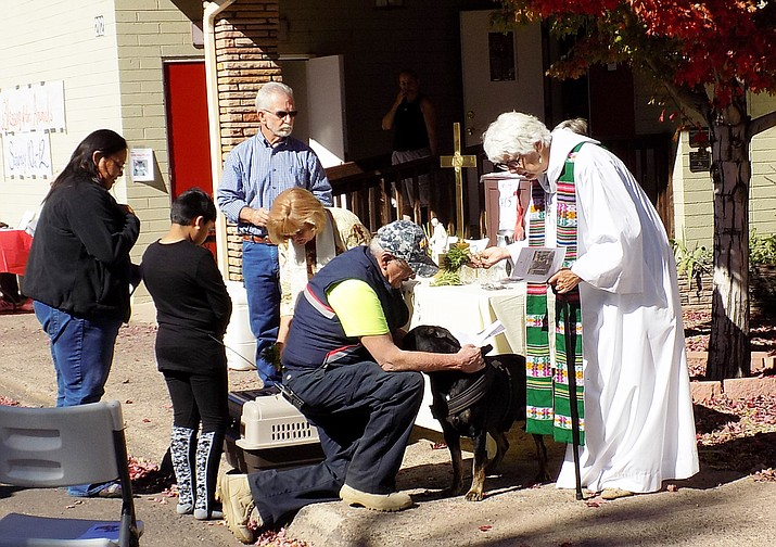 The pastors greeted each owner, were introduced to the pet and bestowed a blessing and a St. Francis of Assisi medal.