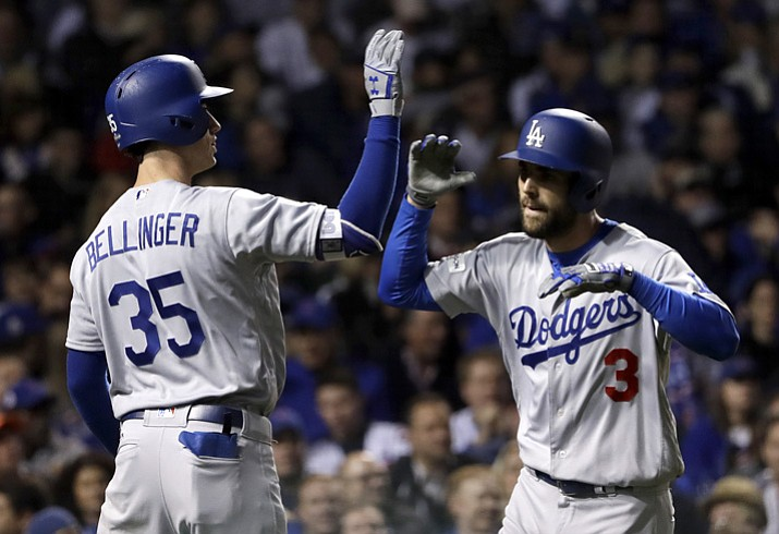Los Angeles Dodgers' Chris Taylor (3) celebrates his home run with Cody Bellinger (35) during the third inning of Game 3 of baseball's National League Championship Series against the Chicago Cubs, Tuesday, Oct. 17, 2017, in Chicago. (Matt Slocum/AP)