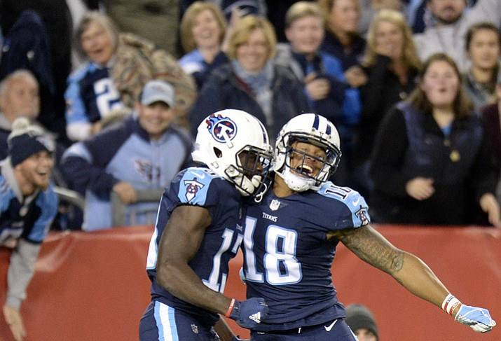 Tennessee Titans wide receiver Taywan Taylor (13) celebrates with Rishard Matthews (18) after Taylor scored a touchdown on a 53-yard pass against the Indianapolis Colts in the second half of an NFL football game Monday, Oct. 16, 2017, in Nashville, Tenn. (Mark Zaleski/AP)