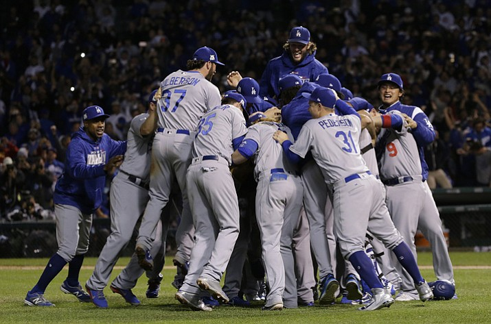 The Los Angeles Dodgers players celebrate after Game 5 of the National League Championship Series against the Chicago Cubs on Thursday, Oct. 19, 2017, in Chicago. The Dodgers won 11-1 to win the series and advance to the World Series. (Nam Y. Huh/AP)