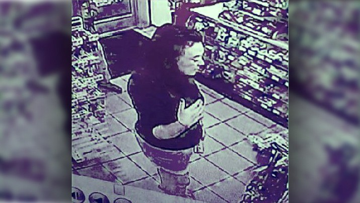 Police say Alexandra Justine Dewsnup stole stole a credit card from a Utah 7-Eleven clerk while he was collapsed on the floor having a seizure. Dewsnup's parents reportedly recognized her from surveillance video and called police. (Unified Police Department)