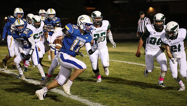 Prescott's Ryan Greene (17) moves the ball forward as the Badgers play the Flagstaff Eagles on Friday night, Oct. 20, in Prescott.