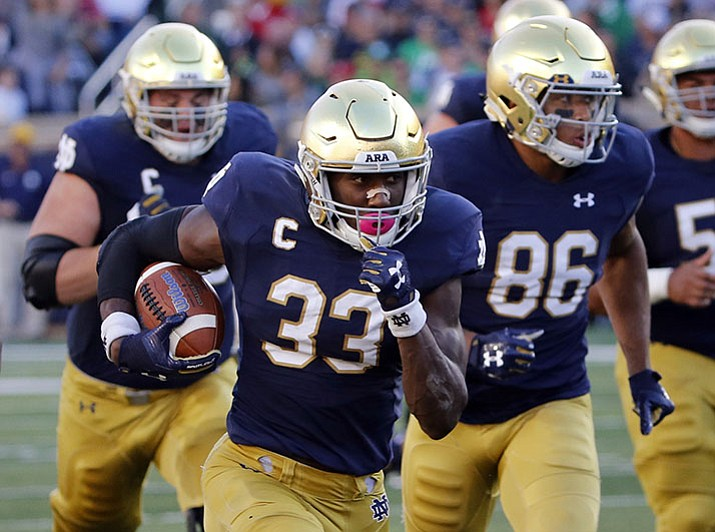 In this Sept. 30, 2017, file photo, Notre Dame running back Josh Adams heads for the end zone on a touchdown against Miami (Ohio) in South Bend, Ind.