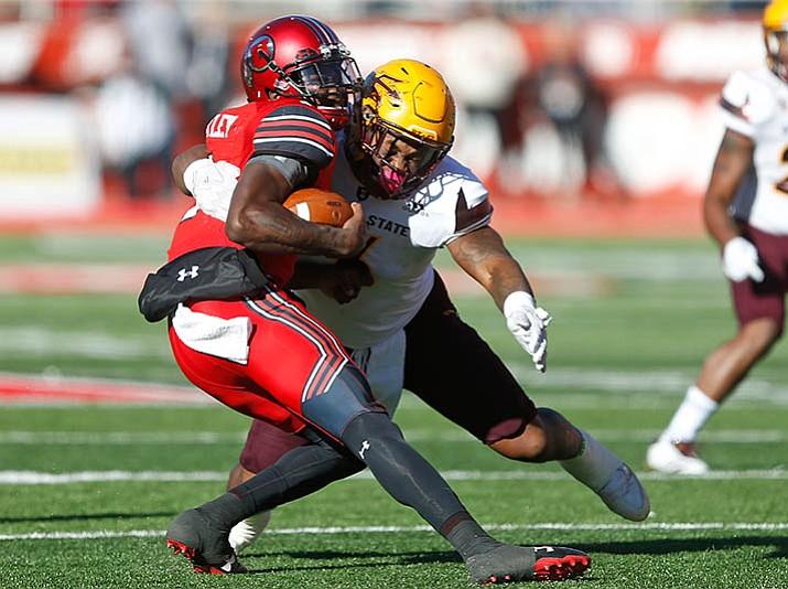 Arizona State linebacker DJ Calhoun, right, sacks Utah quarterback Tyler Huntley in the second half of an NCAA college football game, Saturday, Oct. 21, in Salt Lake City. (Rick Bowmer/AP)