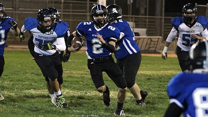 Kingman Academy's Stevie Wusstig rushed for 104 yards and three touchdowns Friday night in a 38-33 win over Paradise Honors.