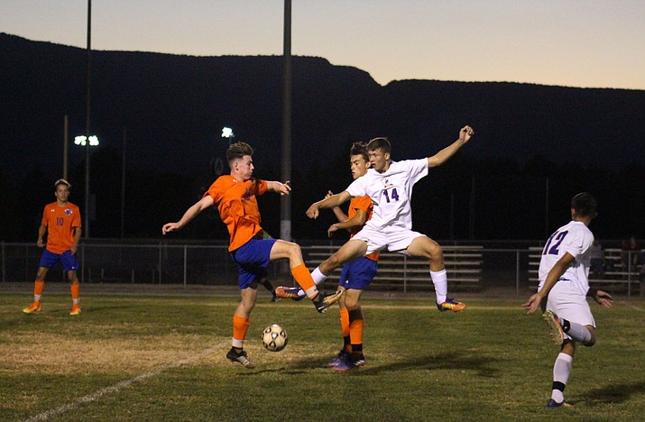 Camp Verde sophomore Jordan Littlefield jumps for the ball against Chino Valley on Thursday night. (VVN/James Kelley)