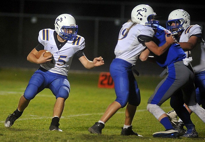 Kingman's Darrell Mitchell runs the ball earlier this season. Mitchell scored in a 36-12 loss Friday to River Valley.