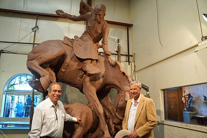 Bronzesmith Ed Reilly, below left, and Loren Phippen, right, the son of George Phippen, discussed the progress recently on the 14-foot-high statue. (Cindy Barks/Courier)