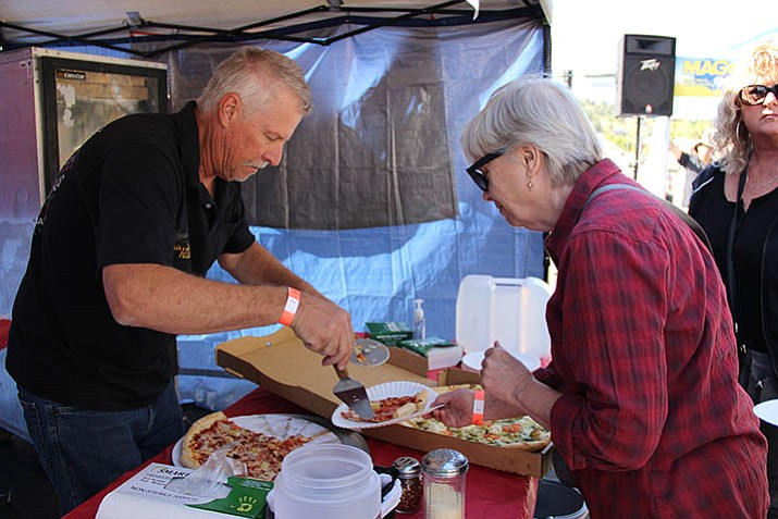 Ron Pikul, owner of Mama's Artisan Pizzeria, serves up his pizza during the Prescott Pizza Palooza on Saturday, Oct. 21, downtown. (Max Efrein/Courier)