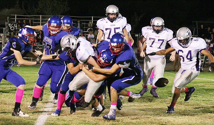 Camp Verde defenders tackle a Sedona Red Rock ball carrier last year. The Cowboys beat their rival 12-8. (VVN/Bill Helm)
