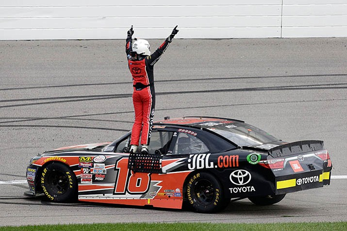 Christopher Bell celebrates winning the NASCAR Xfinity Series auto race at Kansas Speedway in Kansas City, Kan., Saturday, Oct. 21. (Colin E. Braley/AP)