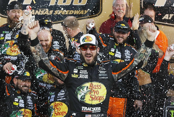 Martin Truex Jr. celebrates winning the NASCAR Cup Series auto race at Kansas Speedway in Kansas City, Kan., Sunday, Oct. 22, 2017. (Colin E. Braley/AP)