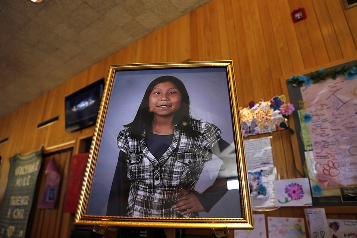 A portrait of Ashlynne Mike on display inside the lobby of the Farmington Civic Center in Farmington, N.M. Tom Begaye, who pleaded guilty to murder and sexual assault in the death of the 11-year-old on the largest American Indian reservation, was sentenced to life in prison on Friday, Oct. 20, 2017. (Jon Austria/The Daily Times via AP, File)