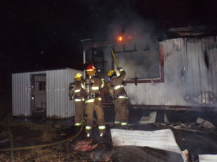 Firefighters work to smother flames Saturday in Butler.