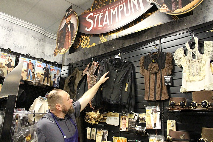 Brian Brown, district manager for Spirit Halloween, shows some of the steampunk costumes for sale at his store, 3990 Stockton Hill Road. Superheroes and movie characters are the most popular Halloween costumes, he said.