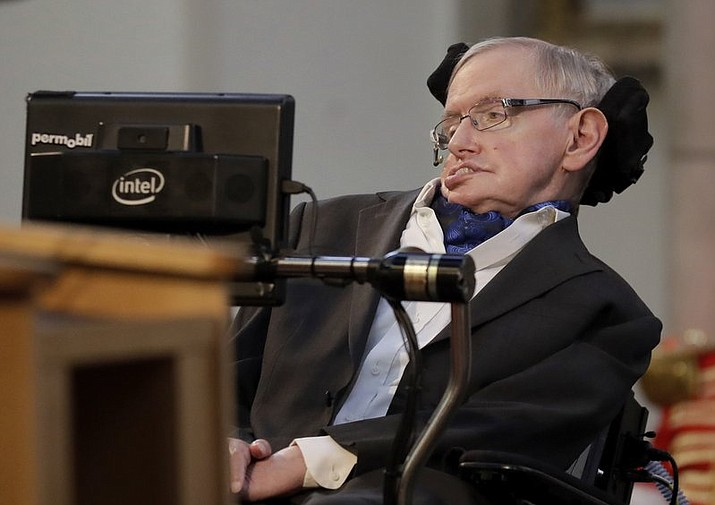 "Britain's Professor Stephen Hawking receives the Honorary Freedom of the City of London during a March 2017 ceremony in London. Cambridge University put Hawking's doctoral thesis online Monday, triggering such interest that it crashed the university's website. Completed in 1966 when Hawking was 24, ""Properties of Expanding Universes"" explores ideas about the origins of the universe that have resonated through the scientist's career. (AP Photo/Matt Dunham, file)"