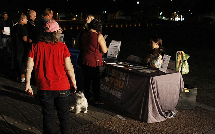 Attendees of the 22nd Annual Candlelight Celebration for Mental Health walk around the many booths offering information about community resources.