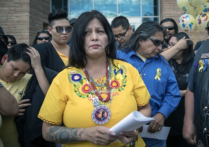 Pamela Foster, foreground, and Gary Mike, center background, parents of Ashlynne Mike, prepare to make a statement after their daughter's killer Tom Begaye was sentenced to life in prison, Friday, Oct. 20, 2017 outside of a federal courthouse in downtown Albuquerque, N.M.. Tom Begaye was sentenced Friday to life in prison without parole as part of a plea deal in the 2016 rape and murder of 11-year-old Ashlynne Mike. Roberto E. Rosales/The Albuquerque Journal via AP