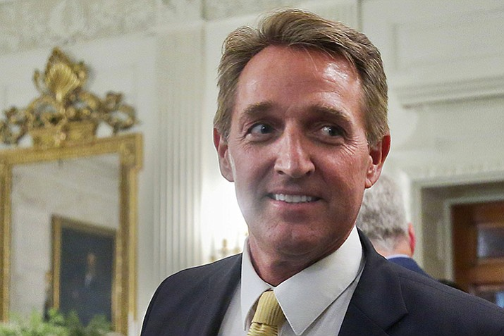 Sen. Jeff Flake, R-Ariz., walks to his seat as he attends a luncheon in July with other GOP Senators and President Donald Trump at the White House in Washington. Flake, a frequent critic of President Donald Trump, announced on Oct. 24, he won't seek re-election.