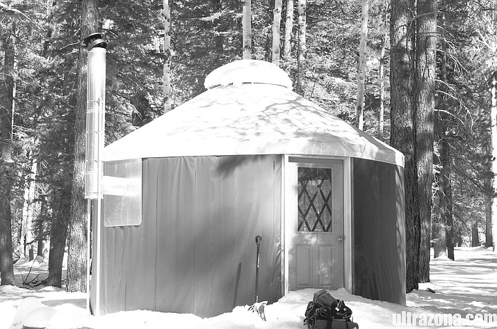 The North Rim yurt was covered in snow after a winter storm.