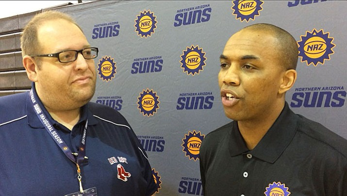 Brian M. Bergner Jr., sports editor for The Daily Courier, talks with former Northern Arizona Suns head coach Tyrone Ellis during media day last season. (Brian M. Bergner Jr./Courier)