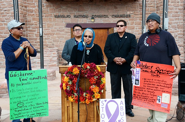 "Emma Thompson, also known as ""Grandma Emma"" with Speaker LoRenzo Bates and Council Delegates Nathaniel Brown and Steven Begay at the Navajo Nation Council Chamber in Window Rock, Arizona Oct. 19. Thompson began her two day walk from Gallup, New Mexico Oct. 18 to bring awareness to domestic violence  on the Navajo Nation. Submitted photo"