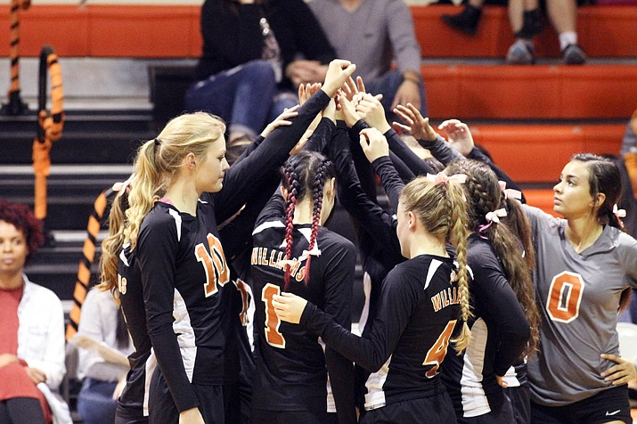 The Lady Vikes celebrate the win after beating Basis in three sets Oct. 19.