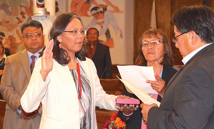 Tina Tsinigine takes the oath of office administered by acting Navajo Nation Chief Justice Thomas J.Holgate after being confirmed as a probationary judge by the Navajo Nation Council.