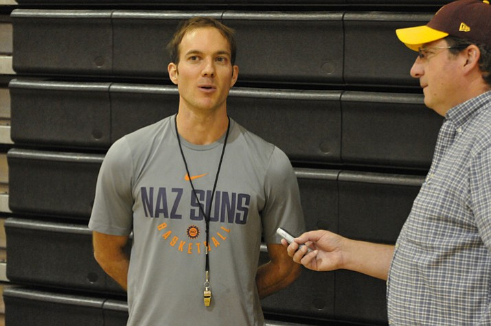 Northern Arizona Suns interim head coach Tyler Gatlin is interviewed by sports writer Doug Cook of The Daily Courier during the first day of training camp Tuesday, Oct. 24, 2017, in Prescott Valley. (Brian M. Bergner Jr./Courier)
