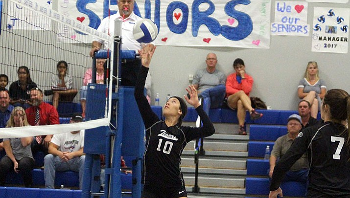 Kingman Academy's Shaunti Short sends a ball over the net Tuesday night against Mohave Accelerated. The Lady Tigers won 3-0.