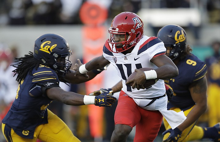 Arizona quarterback Khalil Tate, center, runs for a touchdown past California linebacker Alex Funches, left, during the first half of Saturday's football game in Berkeley, Calif. (Marcio Jose Sanchez, AP file)