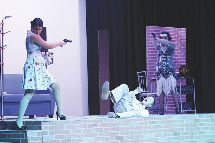 From left, Lenny (Elisa Jenkins), Patrick (Gabriel Runner) and Ruth (Celeste Velazquez) freeze after Lenny shoots Patrick in the loft.