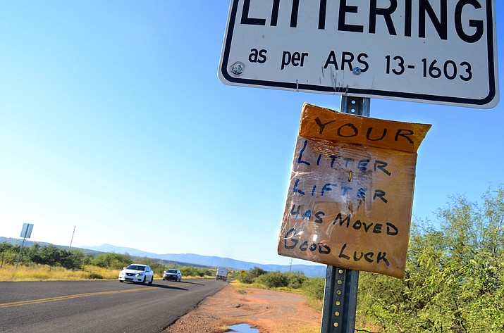 "East Prairie Lane is being covered in litter after a sign was posted reading: ""Your Litter Lifter Has Moved. Good Luck."" Prairie Lane is a half-mile road, just south of Western Drive connected to SR 260. (Vyto Starinskas)"