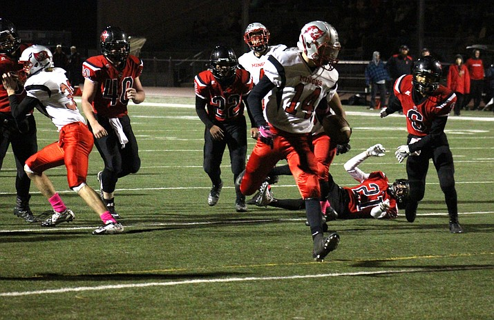 Mingus junior Colby Fanning scores a touchdown during the Marauders' 56-0 win at Coconino. The victory clinched at least a share of the region title for Mingus Union. (VVN/James Kelley)