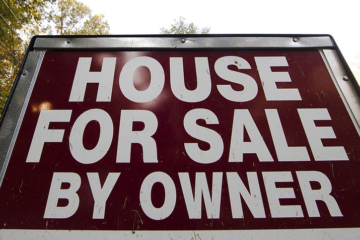 "This Tuesday, Oct. 17, 2017, photo shows a ""House for Sale by Owner"" sign in a yard in Fort Washington, Pa. On Friday, Oct. 20, 2017, the National Association of Realtors reports on sales of existing homes in September. (AP Photo/Matt Rourke)"