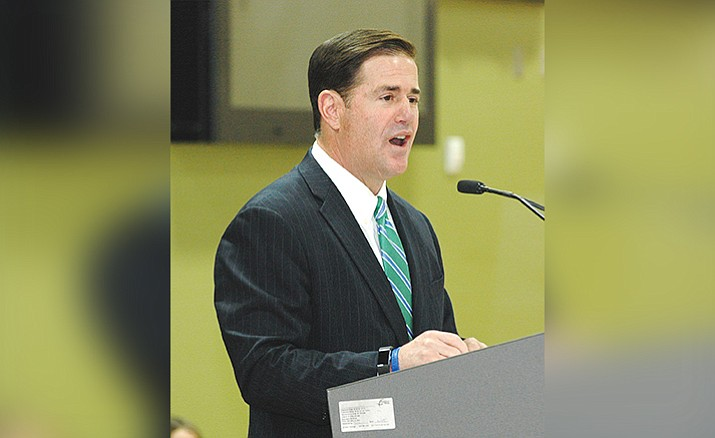"Gov. Doug Ducey: ""We're getting things done in the state of Arizona. I challenge Washington, D.C. to get something done.'' Photo by Howard Fischer"