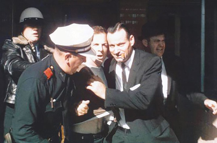 Lee Harvey Oswald was arrested at the Texas Theatre, Dallas, Texas, on Nov. 22, 1963. Scholars and sleuths were waiting Thursday for the release of the John F. Kennedy assassination files.