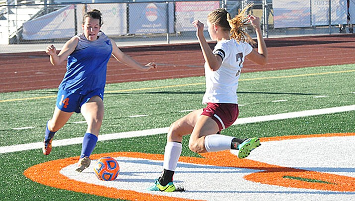 Chino Valley freshman forward Julz Elsea drives toward Northland Prep senior defender Laney Page on her way to the goal Saturday afternoon, Oct. 28, 2017, in the 2A girls' soccer state championship match at Campo Verde High School in Gilbert.