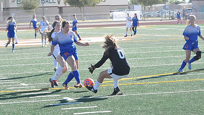 Chino Valley girls' soccer forward Julz Elsea runs into Round Valley goalie Madi Mariscal as she drives toward the Elks' goal in their 2A state semifinal game Friday afternoon, Oct. 27, 2017, at Campo Verde High School in Gilbert. The Cougars won the match, 3-1, to advance to the state championship match against Northland Prep today.