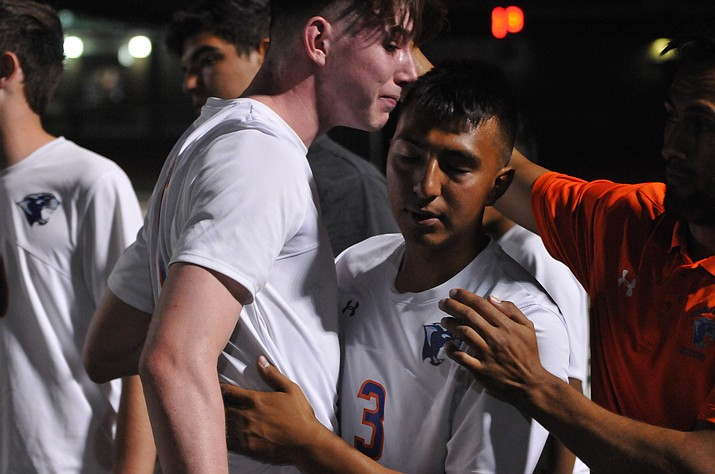 Chino Valley boys' soccer senior midfielder Arlin Pina and senior defender Ethan Christie console each other after the Cougars lost, 1-0, to Phoenix Country Day in the 2A state semifinals Friday night, Oct. 27, 2017, at Campo Verde High School in Gilbert.