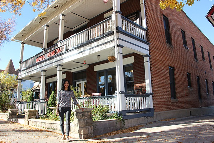 Sonali Patel stands in front of the Hotel Vendome, which she co-owns with her brother, Nikhil. (Max Efrein/Courier)