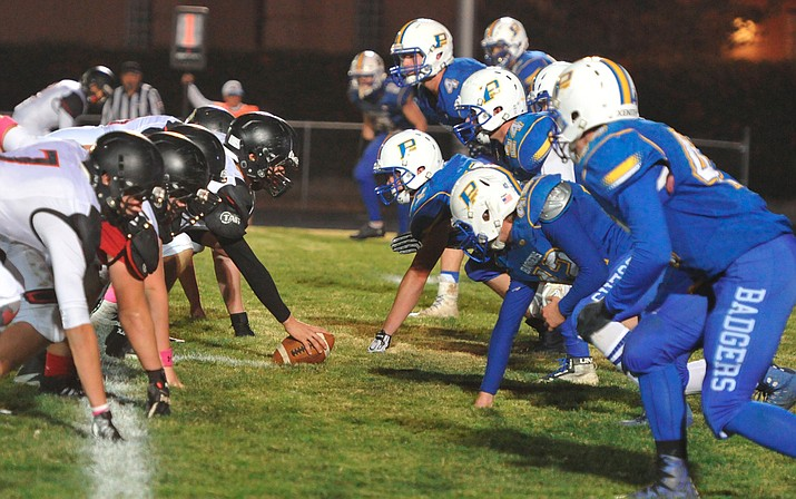 The Prescott Badgers' defense lines up against rival Bradshaw Mountain on Friday, Oct. 27, 2017, in Prescott. Prescott was on the outside looking in after the AIA released the 4A state playoff bracket Saturday morning, making it the fifth straight season the Badgers have not made the playoffs. (Les Stukenberg/Courier, File)