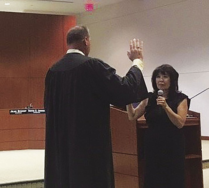 Presiding judge for the Superior Court, Division 1, of Mohave County Charles Gurtler issued the oath of office to Lois Wakimoto Tuesday following a 3-2 vote to appoint her to the Mohave County Board of Supervisors representing District 5.