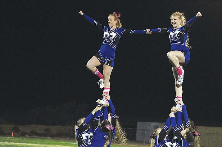 Kingman Academy performs at their final home football game Friday.