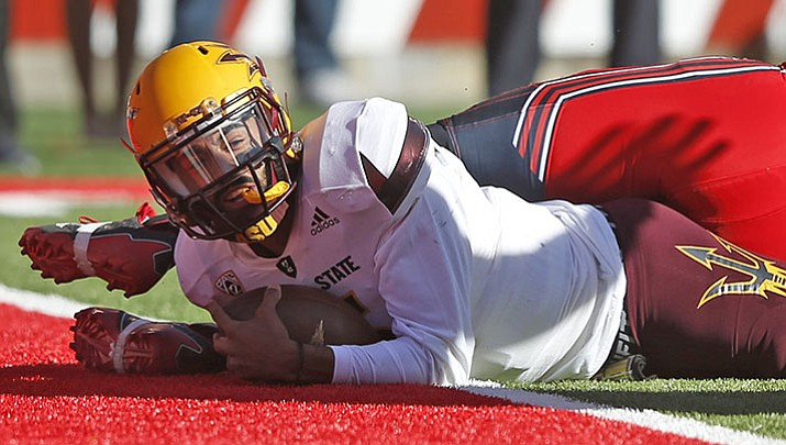 Arizona State quarterback Manny Wilkins (5) scores against Utah in the second half of an NCAA college football game, Saturday, Oct. 21, 2017, in Salt Lake City.