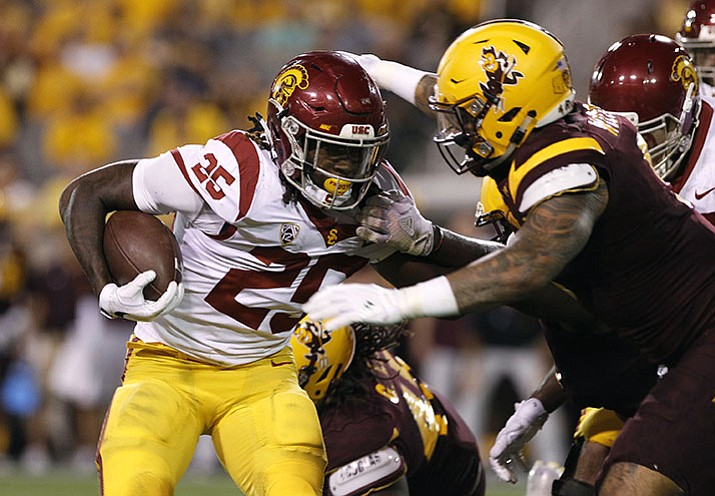 Southern California running back Ronald Jones II runs the ball as Arizona State's Jay Jay Wilson closes in to make the tackle during the first half of an NCAA college football game, Saturday, Oct. 28, 2017, in Tempe.