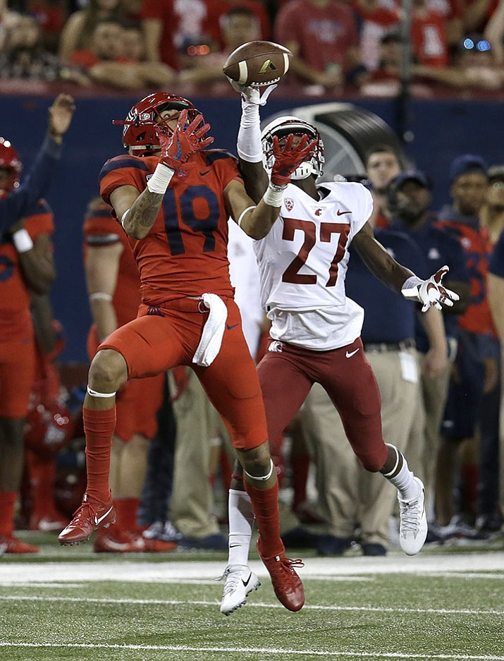 Washington State defensive back Sean Harper Jr. (27) breaks up the pass intended for Arizona wide receiver Shawn Poindexter in the first half during an NCAA college football game, Saturday, Oct. 28, 2017, in Tucson.