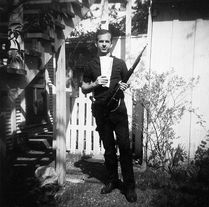 Lee Harvey Oswald with rifle, taken in Oswald's backyard, on Neely Street in Dallas March 1963.