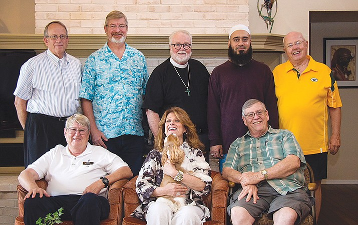 The Kingman United Pastoral Association made up of community spiritiual leaders is hosting a forum on holy days at 5 p.m. today. KUPA members are: front row (left to right)  Paul Pitts, Rabbi Mindie Snyder, Father Leonard Walker. Back row (left to right) Vance Miller, Rev. Don Hegeman, Father Phillip Shaw, Imam Umar Farooq Mahmood, Rev. Ray Christenson.