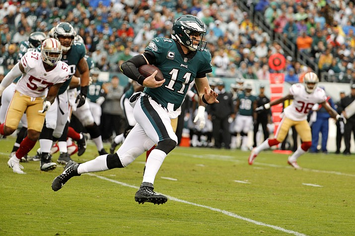 Philadelphia quarterback Carson Wentz (11) runs the ball during an NFL football game against San Francisco, Sunday, Oct. 29, in Philadelphia. (Chris Szagola/AP)